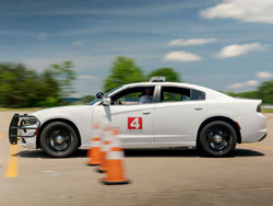 training car navigates through cones